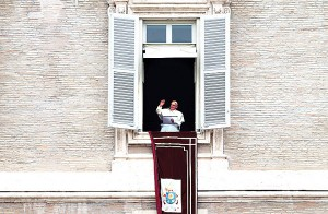 Pope Francis waves to believers during his Angelus Prayer from the window of his office in St. Peter Square. Vatican City, 23 March: photo - EPA/CLAUDIO PERI