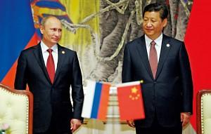 Prezydent Rosji Władimir Putin (z lewej) i Chin - Xi Jinping fot.Alexey Druginyn/RIA Novosti/PAP/EPA