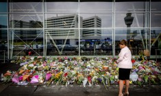 A woman looks at flowers left in commemoration for the victims of Malaysian Airlines flight MH17 at Schiphol Airport, near Amsterdam, the Netherlands, 21 July 2014. Malaysia Airlines Boeing 777 flight MH17 with more than 280 passengers, including 193 Dutch passengers on board was downed in eastern Ukraine on 17 July. Malaysian leaders from all sides of the political divide expressed disappointment with Russia for failing to exert its influence over separatist rebels in Ukraine controlling the crash site of downed Malaysia Airlines flight MH17.  EPA/ROBIN VAN LONKHUIJSEN