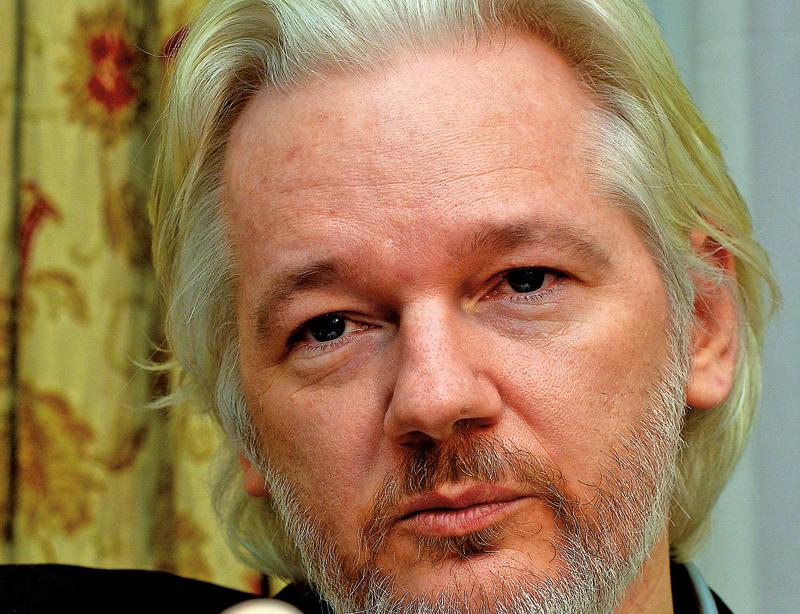 Julian Assange fot.John Stillwell/Press Association/EPA