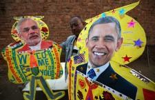 Kite maker shows kites with pictures of US President Barack Obama and Indian Prime Minister Narendra Modi on them in Amritsar.