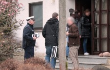 Police officers search a house in Montabaur in the aftermath of Germanwings plane crash