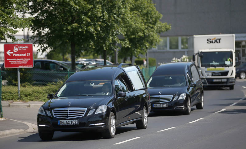 epa04792008 Hearses pass the airport in Duesseldorf, Germany, 10 June 2015. Eleven weeks after the crash of a Germanwings plane in the French Alps, the bodies of the first victims are being brought back to Germany. Most of the victims of Germanwings flight 4U9525 were German nationals, including 16 pupils from the city of Haltern am See.  EPA/OLIVERBERG