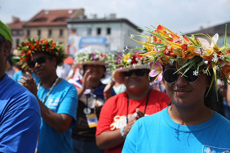 epa05447239 Pilgrims participating in World Youth Day 2016 are seen on the street in the centre of Wadowice, the home town of St. John Paul II in Wadowice, Poland, 29 July 2016. The World Youth Day 2016 is held in Krakow and nearby Brzegi from 26 to 31 July.  EPA/STANISLAW ROZPEDZIK POLAND OUT