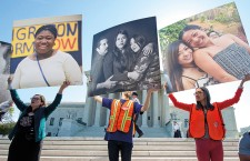 Immigration supporters rally outside the Supreme Court