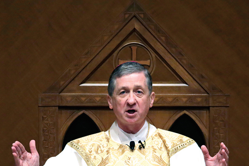 epa04495018 Archbishop Blase Cupich reads from the cathedra after his Installation Mass at Holy Name Cathedral in Chicago, Illinois, USA, 18 November 2014. Cupich becomes the ninth Archbishop of Chicago. He succeeds retiring Cardinal Francis George who has held the position since 1997.  EPA/CHARLES REX ARBOGAST / POOL