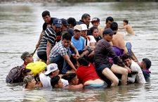Honduran migrants cross the river that separates Guatemala and Mexico, Tecum Uman - 20 Oct 2018