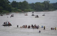 Dozens of migrants cross the river that separates Guatemala and Mexico on foot, Tecun Uman - 20 Oct 2018
